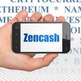 Concetto di Cryptocurrency: Mano che tiene Smartphone con Zencash su esposizione Immagini Stock Libere da Diritti
