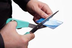Concetto di debiti di taglio - forbici e carta di credito Fotografie Stock Libere da Diritti