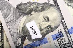Concetto di debito con la nota e la carta del dollaro su priorità alta Immagini Stock Libere da Diritti