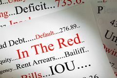 Concetto di debito in rosso fotografia stock
