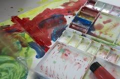 Concetto di divertimento del gioco del bambino di istruzione di colore di acqua di arte immagini stock
