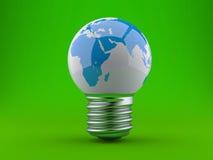 Concetto di energia. Lampadina con la terra del pianeta Fotografie Stock