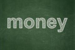 Concetto di finanza: Soldi sul fondo della lavagna Fotografia Stock
