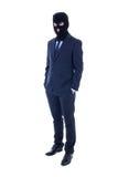 Concetto di frode - uomo in vestito e nella maschera nera isolati sopra Fotografia Stock Libera da Diritti