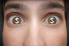 Concetto di gioco Il giovane ha simboli di dollaro nei suoi occhi Fotografia Stock