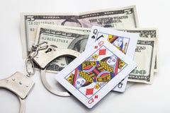 Concetto di gioco illegale con fondo bianco Fotografia Stock