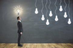 Concetto di idea con la lampadina Immagini Stock Libere da Diritti