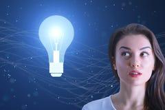 Concetto di idea della donna e della lampadina Fotografia Stock Libera da Diritti