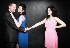 Concetto di infedeltà coniugale. Odio di passione del triangolo amoroso Immagini Stock Libere da Diritti