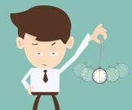 Concetto di ipnosi - mano dell'uomo d'affari che tiene un orologio da tasca e una s Fotografia Stock