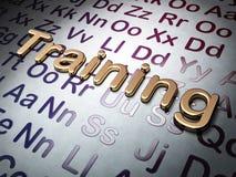 Concetto di istruzione: Addestramento dorato sul fondo di alfabeto Immagine Stock