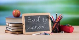 Concetto di istruzione con i rifornimenti di scuola Fotografia Stock Libera da Diritti