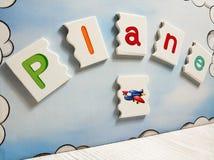 Concetto di istruzione, puzzle piano di parola e simbolo immagini stock libere da diritti