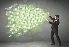 Concetto di lancio dei soldi del giovane uomo d'affari Fotografie Stock