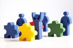 Concetto di lavoro di squadra, della gente e delle icone Fotografia Stock
