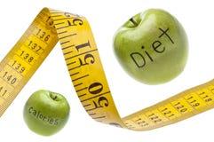 Concetto di misurazione di calorie di dieta del nastro Fotografia Stock