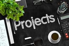 Concetto di progetti sulla lavagna nera rappresentazione 3d immagini stock
