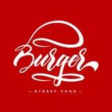 Concetto di progetto di logo dell'alimento dell'hamburger dell'iscrizione della mano Immagini Stock