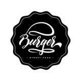 Concetto di progetto di logo dell'alimento dell'hamburger dell'iscrizione della mano Fotografia Stock Libera da Diritti
