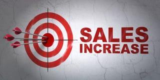 Concetto di pubblicità: aumento di vendite e dell'obiettivo sul fondo della parete Immagini Stock