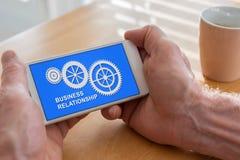 Concetto di relazione di affari su uno smartphone Fotografia Stock Libera da Diritti