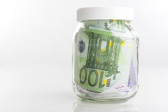 Concetto di risparmio: Pacco delle banconote di moneta europea messe in Ja Fotografia Stock Libera da Diritti