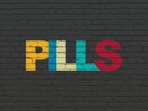 Concetto di salute: Pillole sul fondo della parete Fotografie Stock