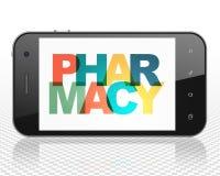 Concetto di salute: Smartphone con la farmacia su esposizione Fotografia Stock Libera da Diritti