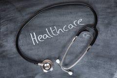 Concetto di sanità con lo stetoscopio Immagini Stock Libere da Diritti