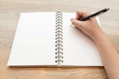 Concetto di scrittura della mano sul taccuino Immagine Stock
