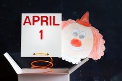 Concetto di simbolo di giorno dei pesci d'aprile con il pagliaccio Fotografia Stock