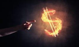 Concetto di soldi che fa con il simbolo di fuoco di valuta del dollaro sul buio Immagine Stock Libera da Diritti