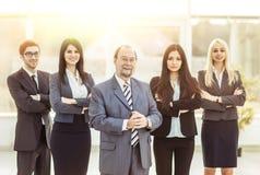 Concetto di successo nell'affare: gruppo professionale di affari sul fondo dell'ufficio Fotografia Stock Libera da Diritti