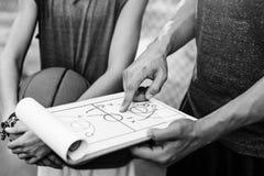 Concetto di tattiche del piano tattico di sport del giocatore di pallacanestro Fotografie Stock Libere da Diritti