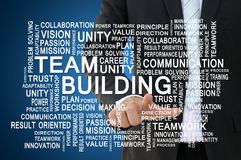 Concetto di team-building e di lavoro di squadra Fotografie Stock