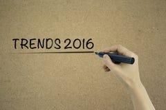 Concetto 2016 di tendenze sul fondo del cartone Fotografia Stock