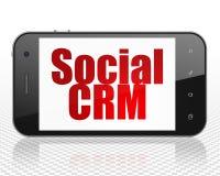 Concetto di vendita: Smartphone con il sociale CRM su esposizione Fotografia Stock