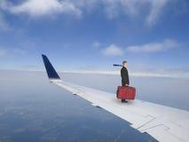 Concetto di viaggio d'affari, uomo d'affari Flying sul getto Fotografie Stock