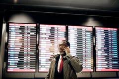 Concetto di viaggio di partenza di arrivo di viaggio d'affari dell'orario fotografia stock libera da diritti