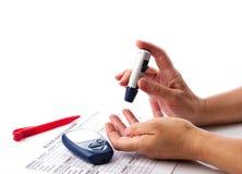 Concetto diabetico con il glucometer Fotografia Stock