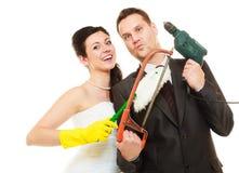 Concetto e coppia sposata di lavoro domestico Immagini Stock