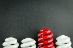 Concetto economizzatore d'energia di affari delle lampadine di differenziazione Fotografia Stock Libera da Diritti