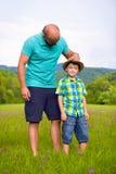 Concetto felice di tempo del figlio e del padre Fotografia Stock