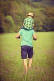 Concetto felice di tempo del figlio e del padre Immagini Stock Libere da Diritti