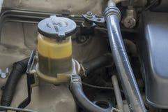 Concetto fluido del meccanico del motore della direzione di potenza del motore Fotografia Stock