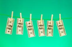 Concetto lavare e di soldi con i dollari immagine stock
