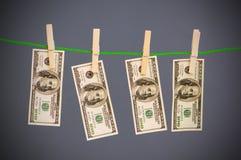 Concetto lavare e di soldi con i dollari immagini stock