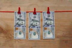 Concetto loundering dei soldi - cento dollari - 100 dollari Fotografia Stock Libera da Diritti