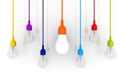 concetto variopinto di differenza della lampadina 3D su fondo bianco Fotografia Stock