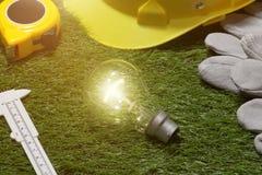 Concetto verde del risparmio energetico e della costruzione: projecj e lavoro della casa Immagine Stock Libera da Diritti